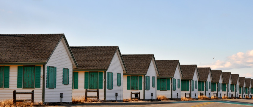 A row of boarded up cottages on Rt. 6A, between Provincetown and Truro, Massachusetts, on a January day