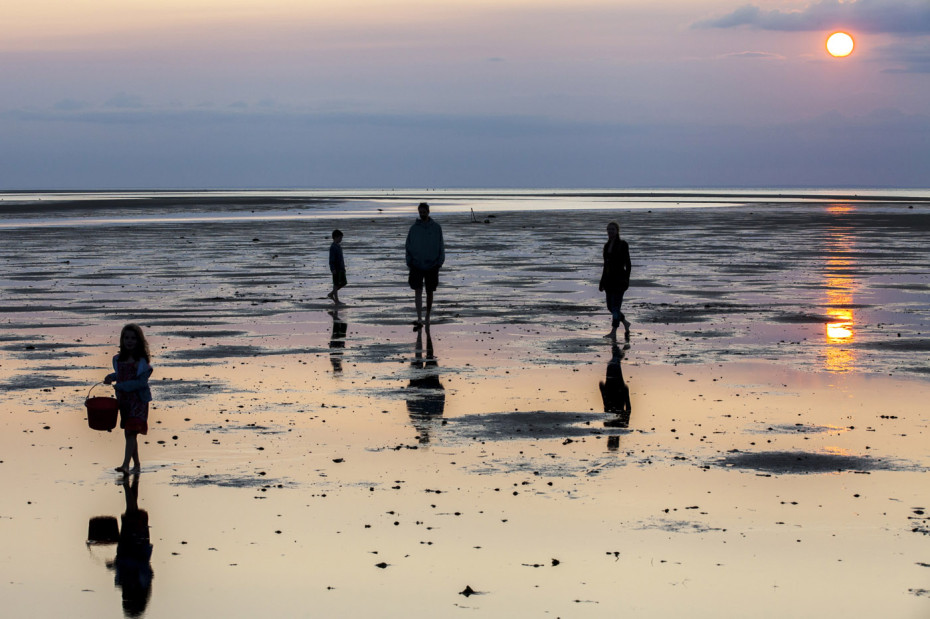 A family explores Breakwater Beach at low tide in Brewster, MA. The bay side of Cape Cod has these wonderfully long low tides that seem to stretch out forever and I'm always amazed at how absolutely exquisite it can be to be out on them at sunset.